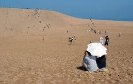 В Японии будут штрафовать туристов за надписи на песке